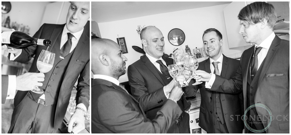 The groom and his groomsmen toast his wedding with champagne