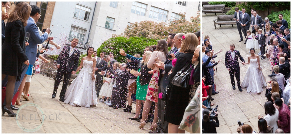 A tunnel of confetti as the bride and groom arrive at St Bride's Foundation in Fleet Street, London