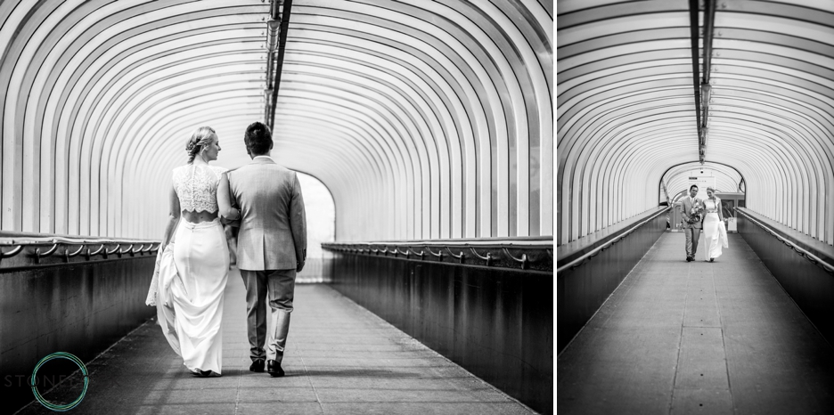 Bride and Groom walk down Festival Pier on the River Thames