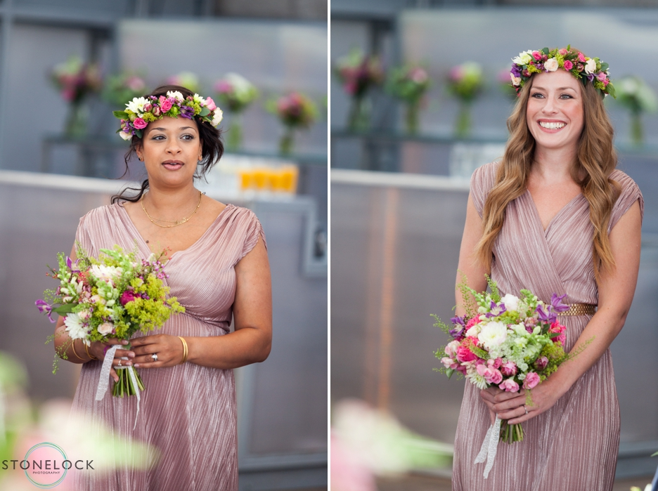 Bridesmaids walk down the aisle at a wedding on The Deck at the National Theatre