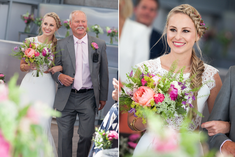 A happy bride and her father walking down the aisle at the Deck, National Theatre.