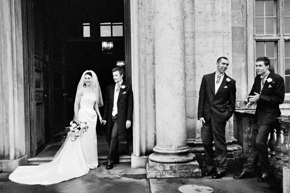 An informal photo of the bride & groom with the best men