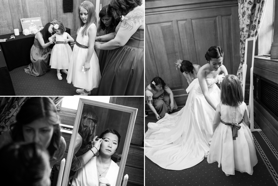 Getting ready for the wedding, the bride helps the flower girls get dressed