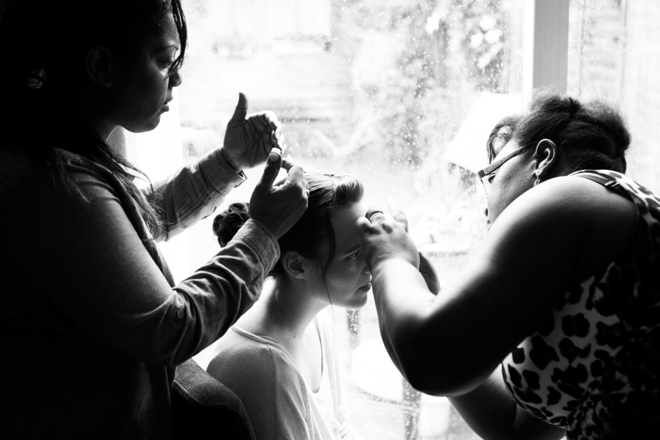 A bride gets her hair and make-up done