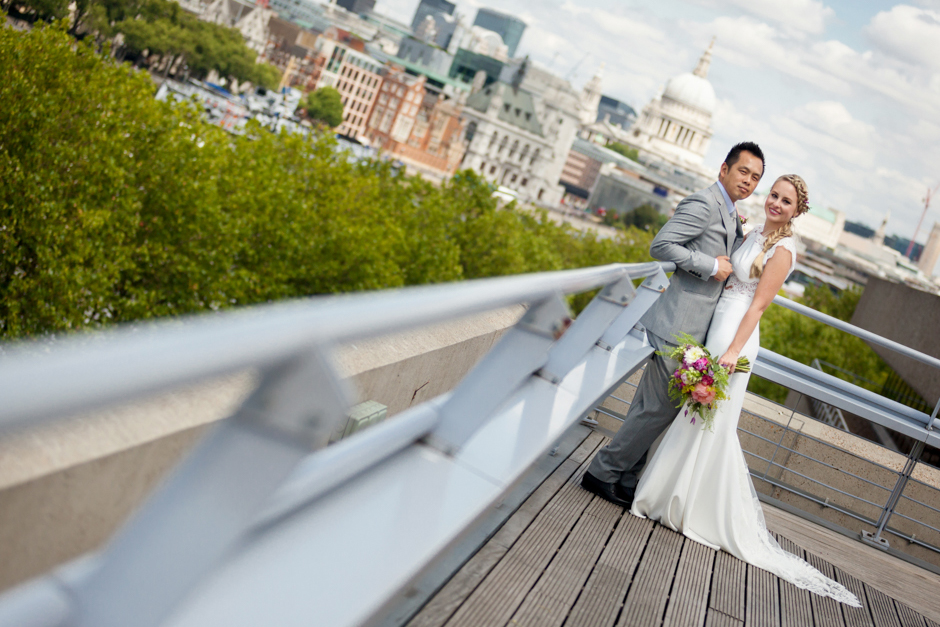 The Bride & Groom pose on the rooftop of the National Theatre overlooking the London skyline