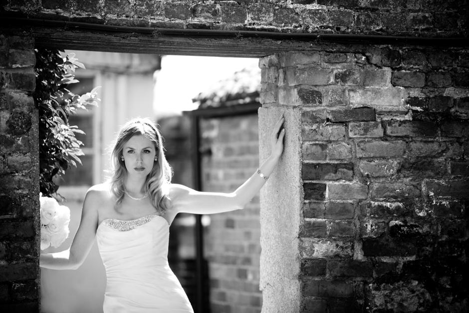 A bride poses