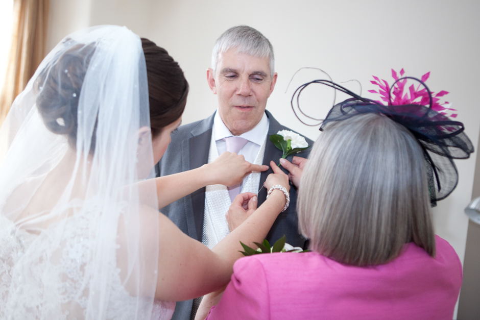 Helping the father of the bride with his button hole...