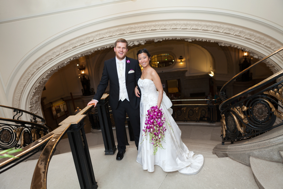 The stunning architecture at Methodist Central Hall in Westminster provides the perfect backdrop for bride & groom portraits