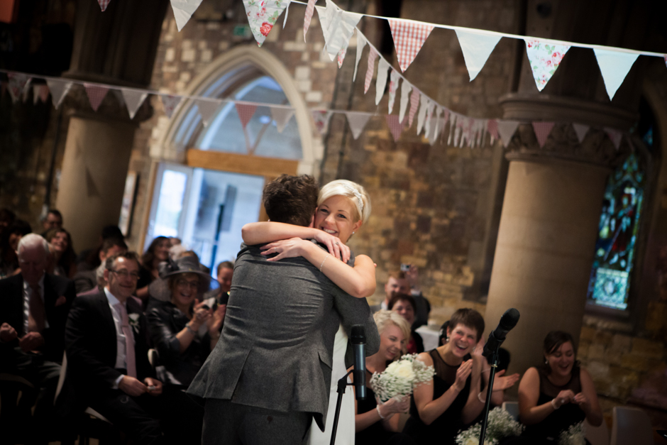 Just married! A celebratory hug by the Bride & Groom as they are pronounced husband & wife