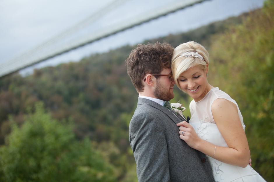 The Bride & Groom pose at the Clifton Suspension Bridge in Bristol