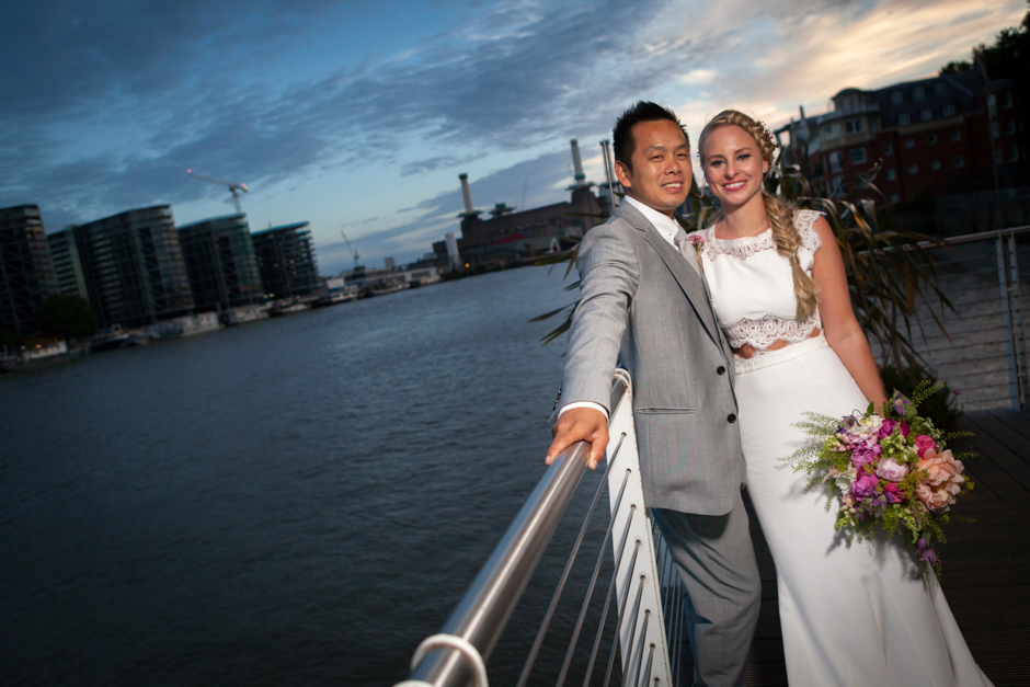 The bride & groom at dusk at the Westminster Boating Base in London