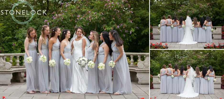 The bride and her bridesmaids in beautiful pale grey dresses