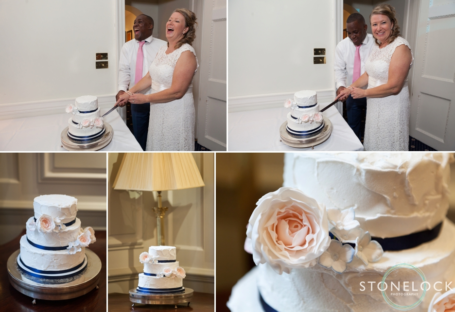 Cutting the wedding cake by Cakes by Caroline at the wedding reception at 170 Queensgate, London