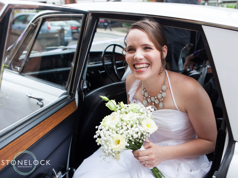 A Guide to Your Wedding Day Timeline: A Bride leaves the wedding car