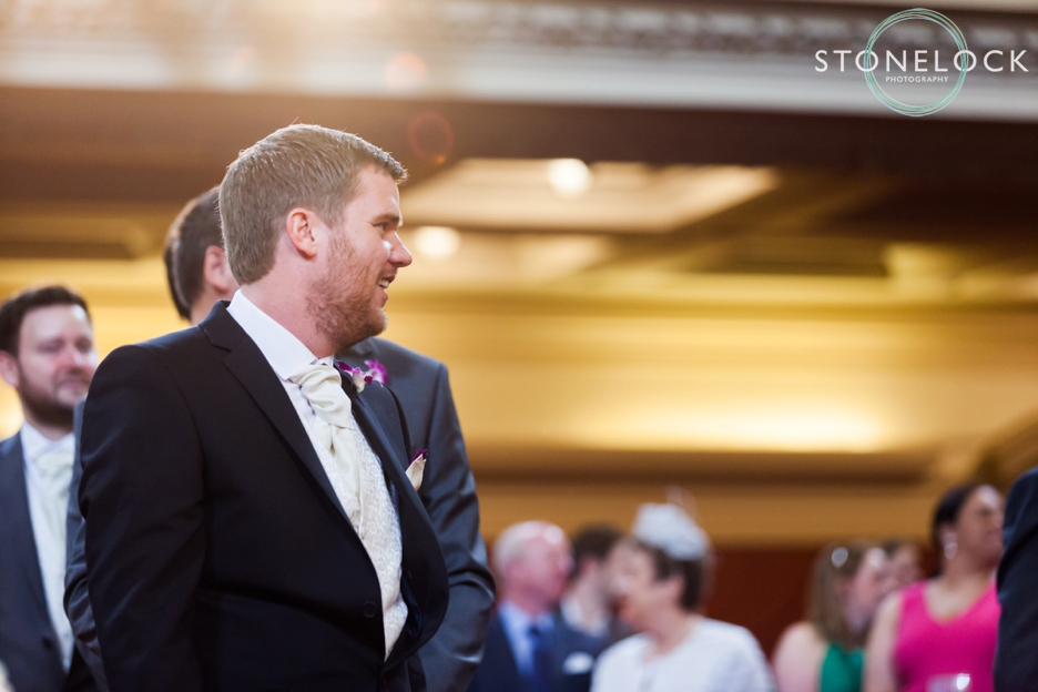 A Guide to Your Wedding Day Timeline: The Groom at the wedding ceremony