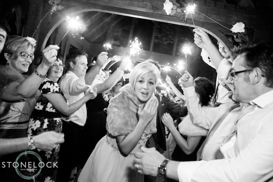 A Guide to Your Wedding Day Timeline: A sparkler exit by the Bride & Groom