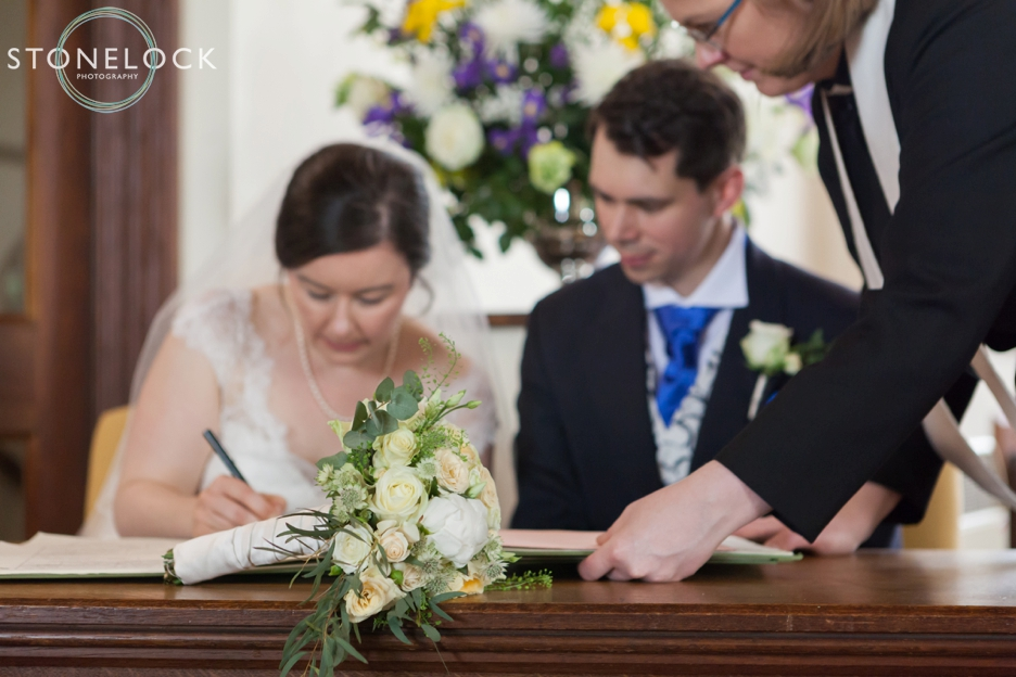 Signing the register at Barnes Methodist Church wedding photography, London
