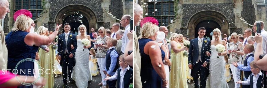Wedding photography at All Saints Church in Carshalton, confetti as the bride and groom leave the ceremony