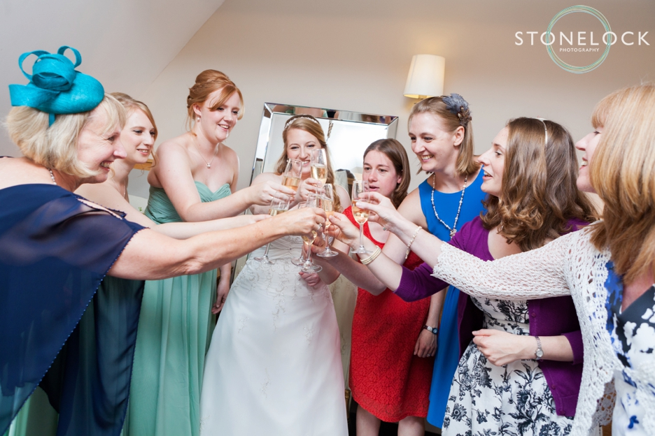 Bride with her best friends before her wedding at Bassmead Manor Barns in Cambridgeshire