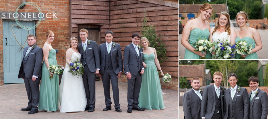 The bridal party pose for wedding photographs at Bassmead Manor Barns in Cambridgeshire