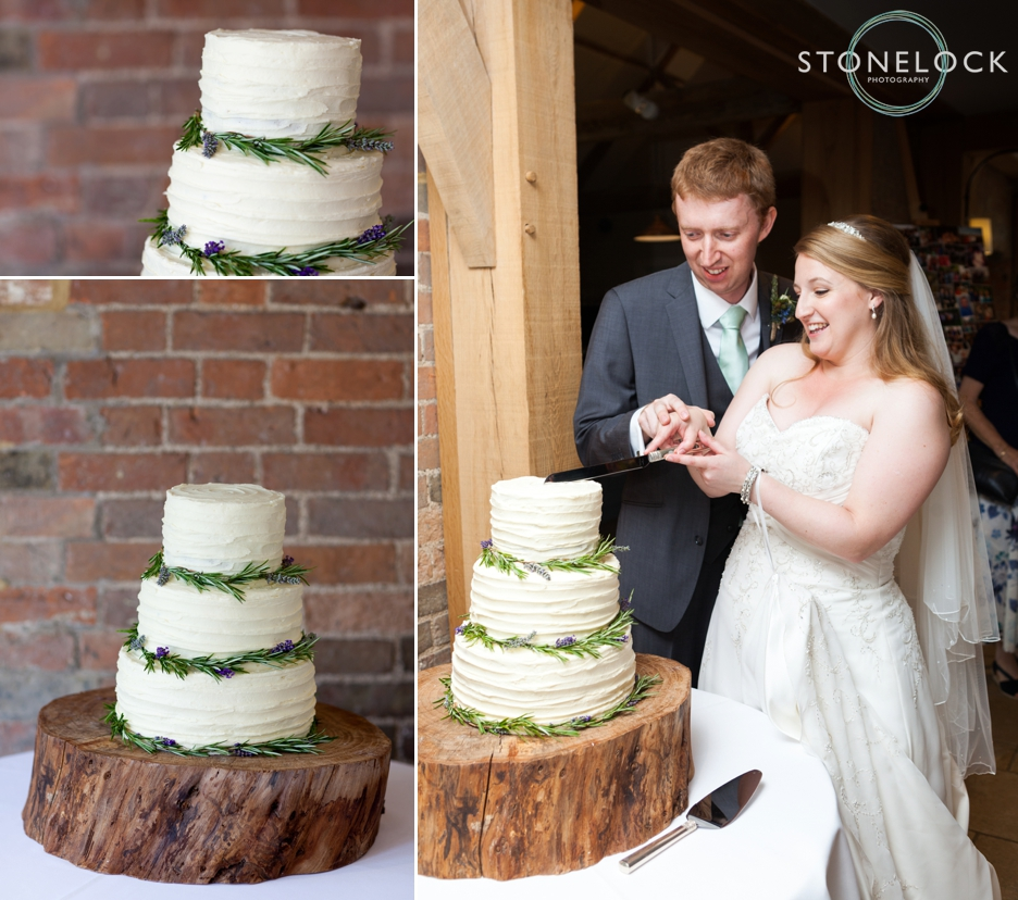 The bride and groom cut the wedding cake at Bassmead Manor Barns in Cambridgeshire