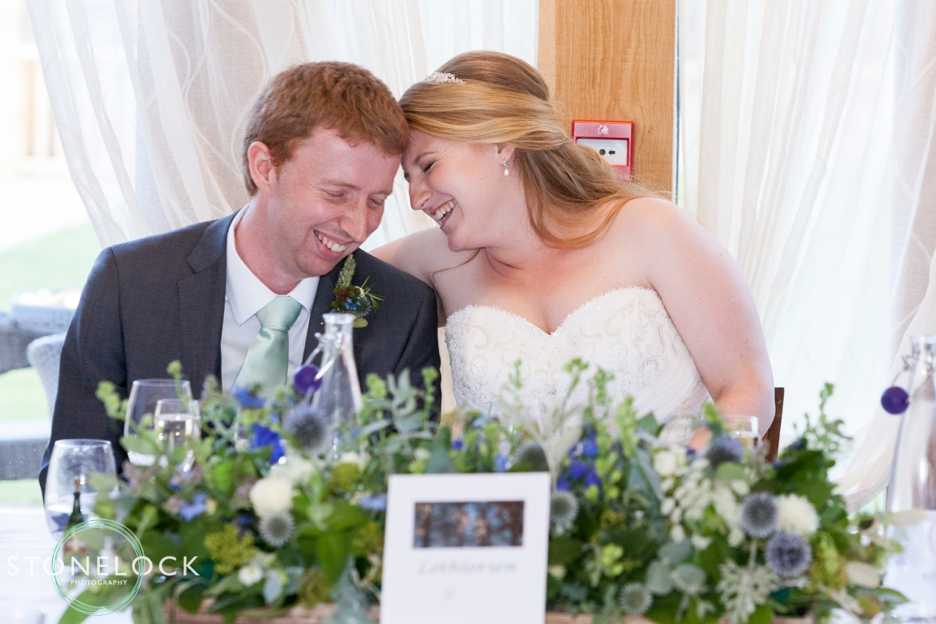 A moment between the bride and groom during the speeches at their wedding wedding at Bassmead Manor Barns in Cambridgeshire
