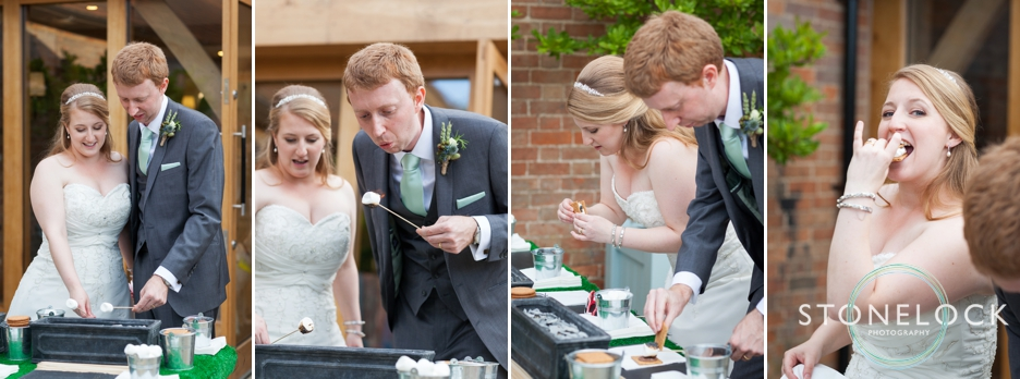 the bride and groom try out the s'more's bar at their wedding at Bassmead Manor Barns in Cambridgeshire