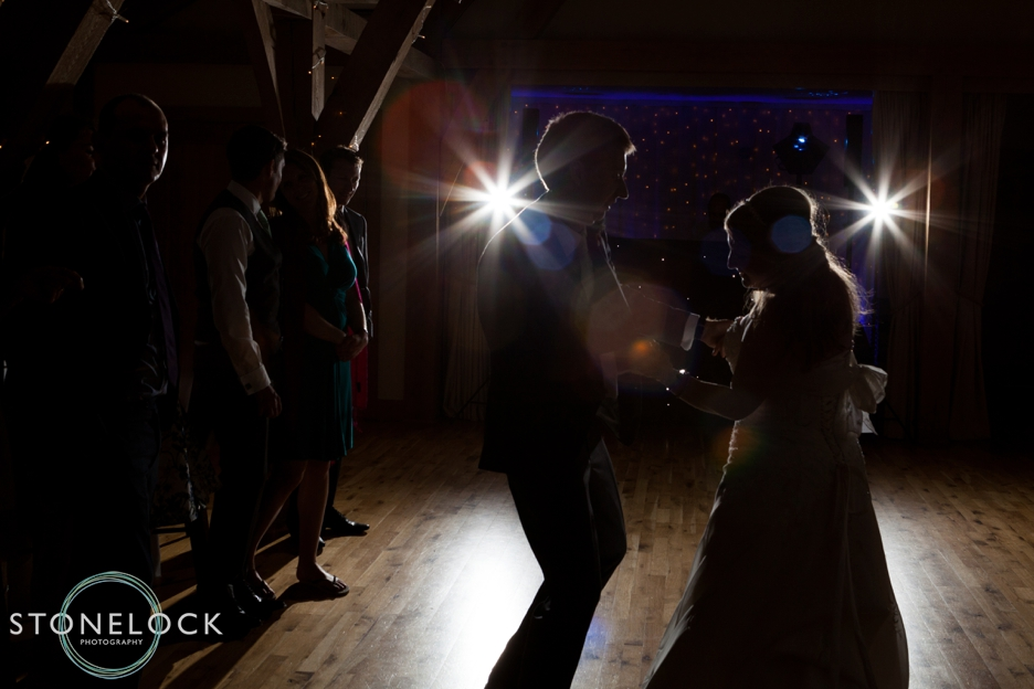 Bride and groom do their first dance at Bassmead Manor Barns in Cambridgeshire for their wedding photography