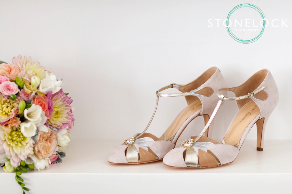 The bride's shoes and bridal bouquet for her London wedding