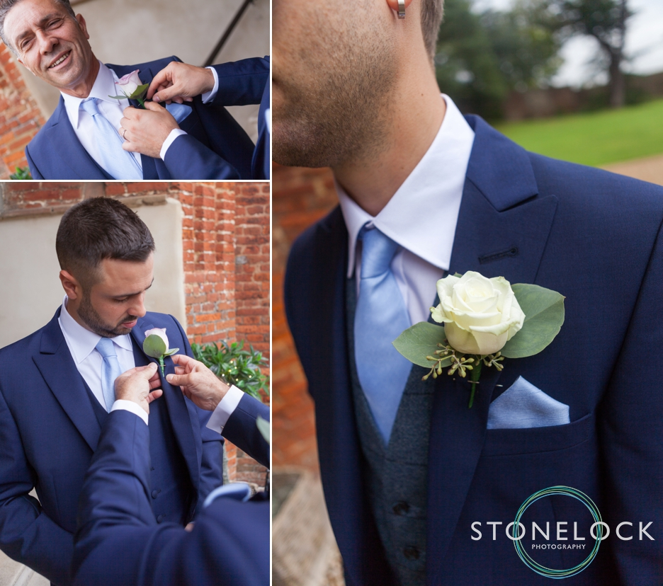 Farnham Castle, Surrey, Wedding photography, the groom puts on his button hole flower