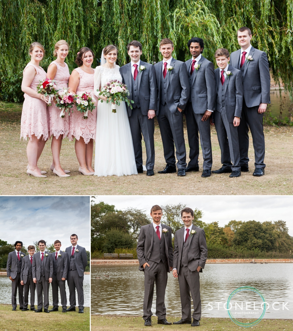 The bridal party pose for photographs at a wedding reception at Forty Hall in Enfield, London