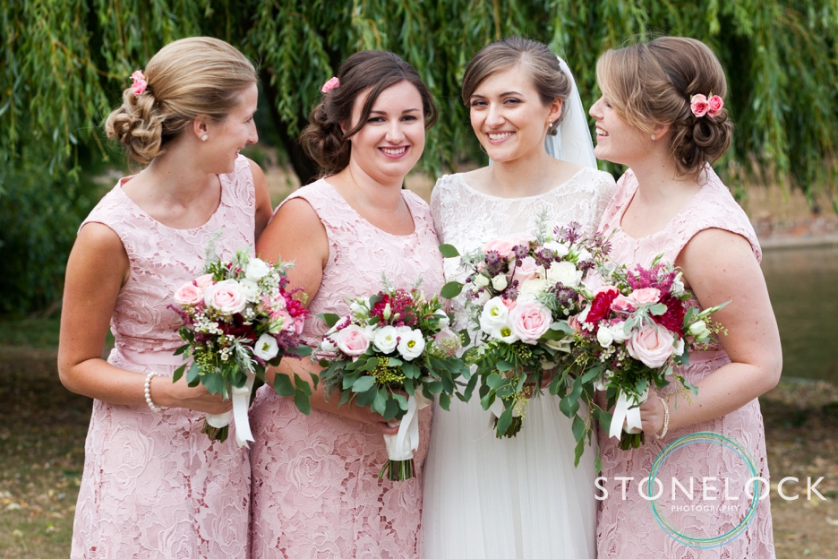 The bride and bridesmaids pose for photographs at a wedding reception at Forty Hall in Enfield, London