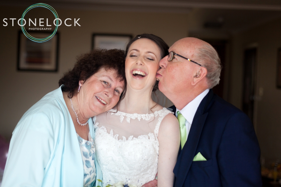 Top tips for great wedding photography, a bride with her parents