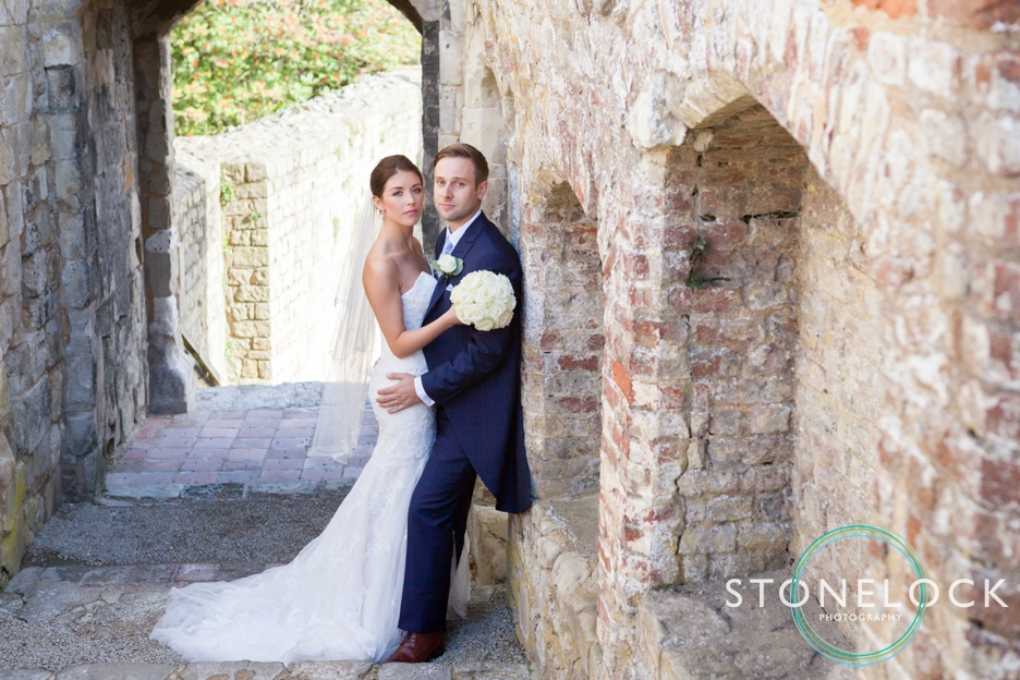 Top tips for great wedding photography, bride & groom pose at Farnham castle