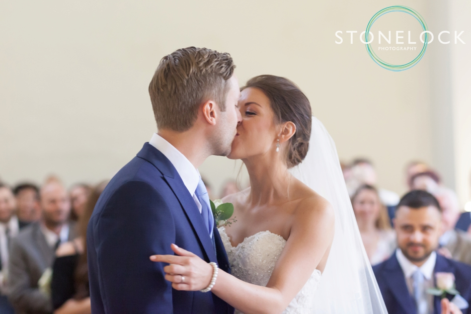 Farnham Castle, Surrey, Wedding photography, the bride & groom kiss