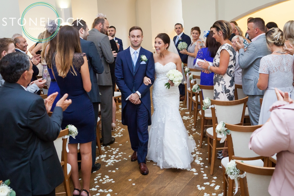 Farnham Castle, Surrey, Wedding photography, the bride & groom walk down the aisle