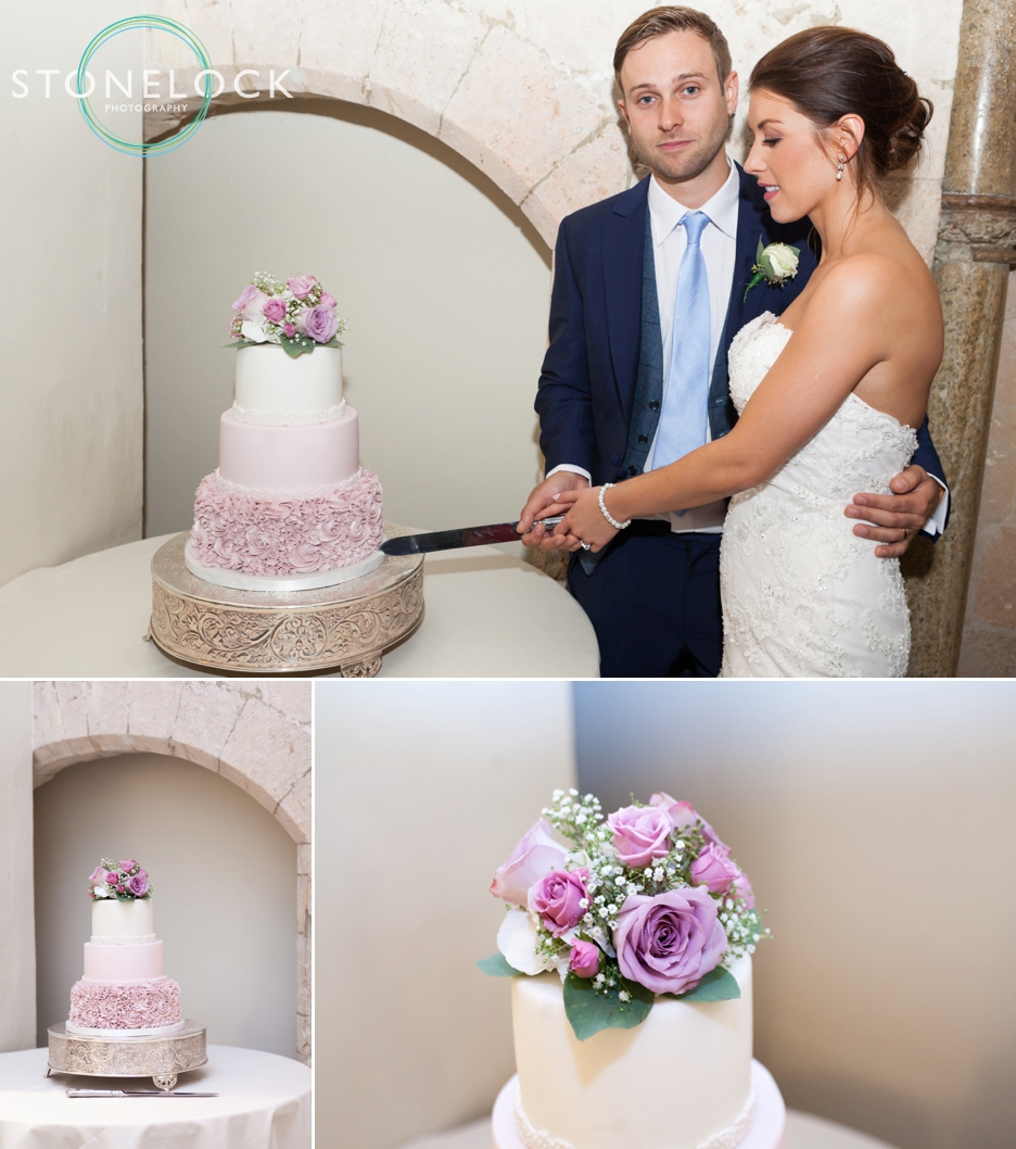 Farnham Castle, Surrey, Wedding photography, bride & groom cutting the wedding cake