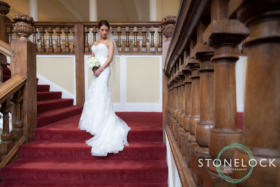 Farnham Castle, Surrey, Wedding photography, bride portrait photo on stairs