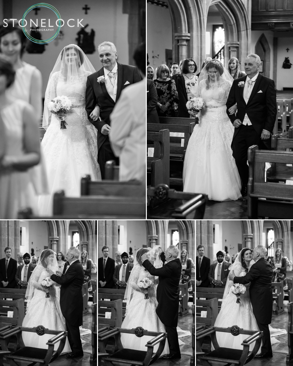 Wedding photography at St Georges Church in Wembley, London, bride walks in with her father