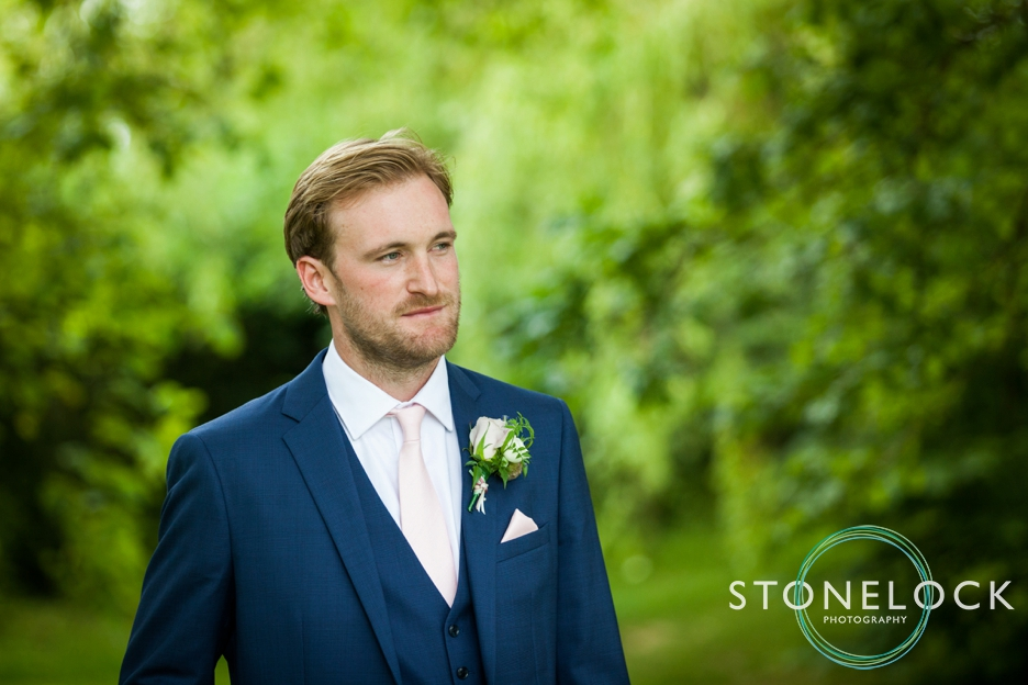 Wedding photography at Ridge Farm Studios, Dorking, Surrey. The groom.