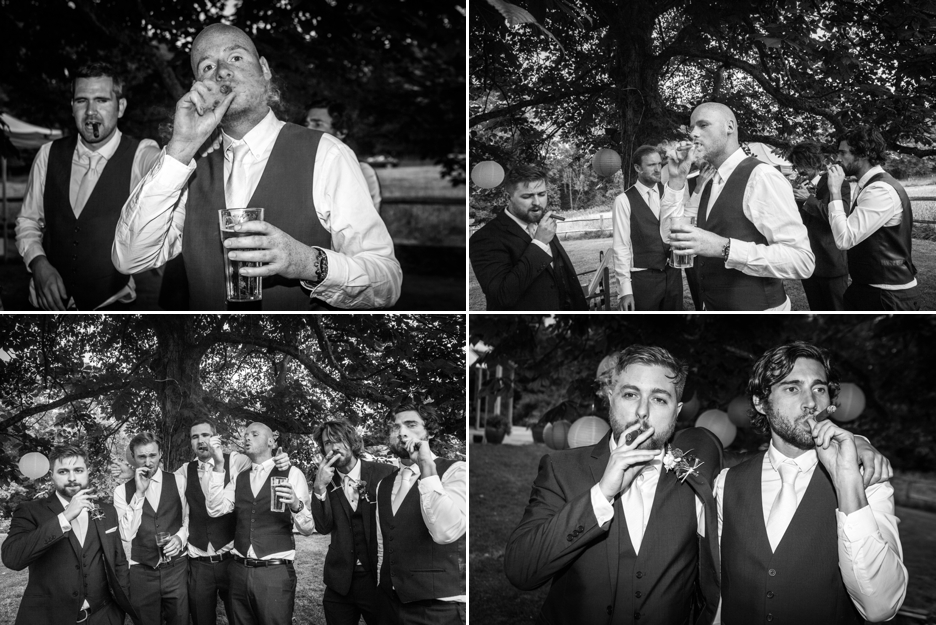 Wedding photography at Ridge Farm Studios, Dorking, Surrey, the groomsmen celebrate with a cigar