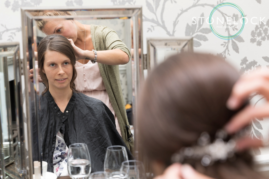 A bride getting her hair done at Morden Hall Weddings