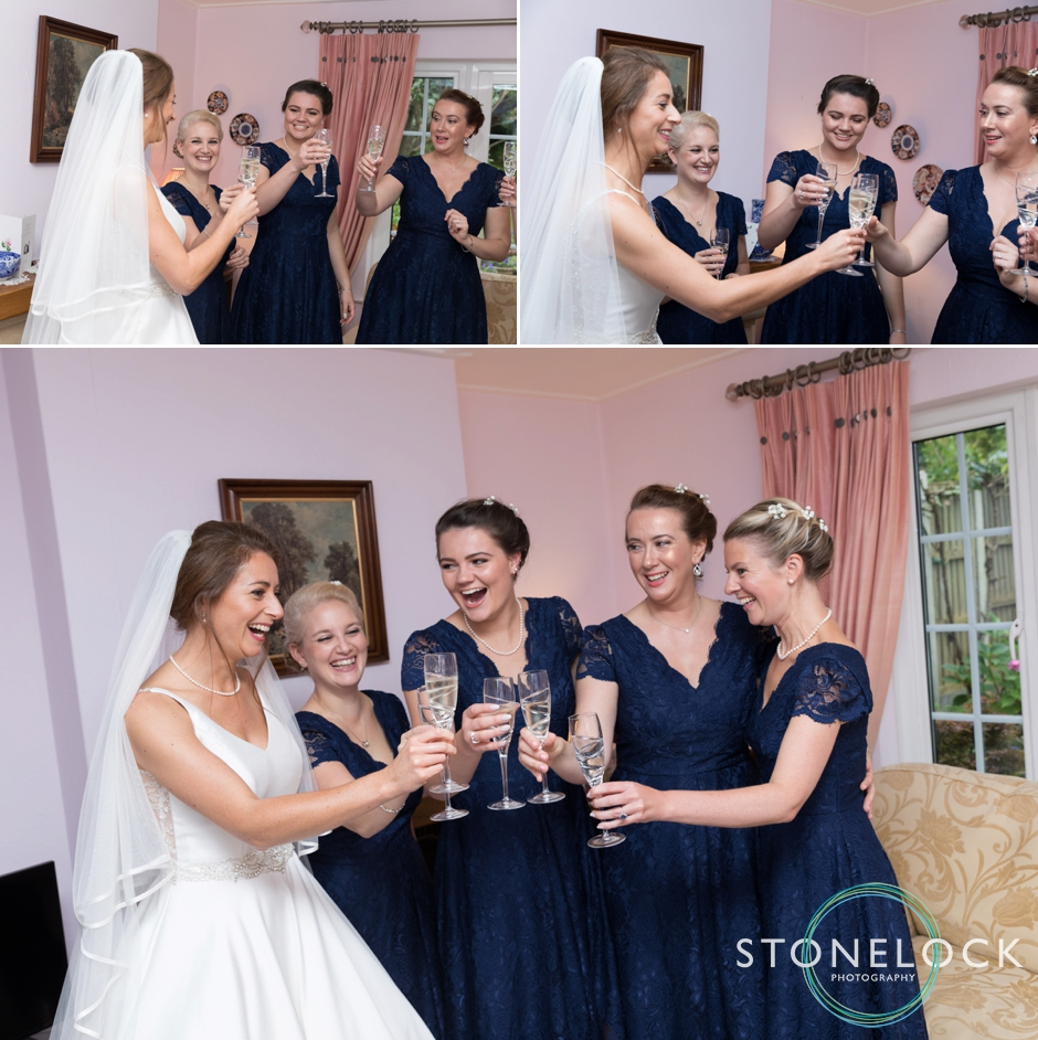 A bride & her bridesmaids celebrate with champagne