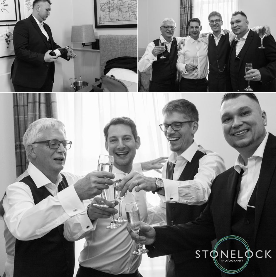 A groom & his groomsmen drink champagne