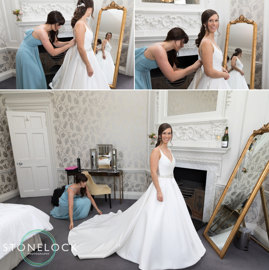 Bride putting on her dress at Morden Hall Weddings