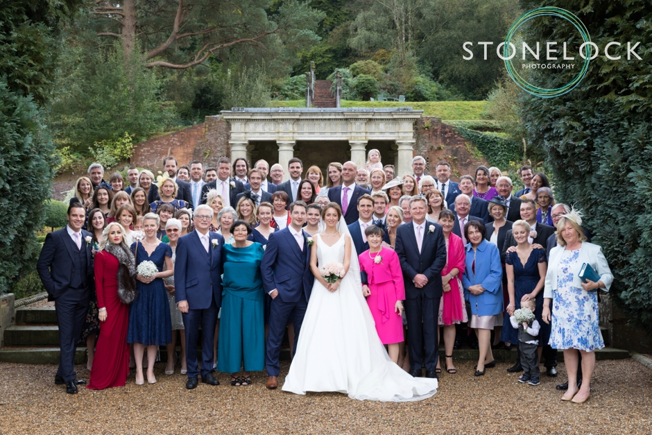 Wotton House wedding photography, a photo of all guests in the garden
